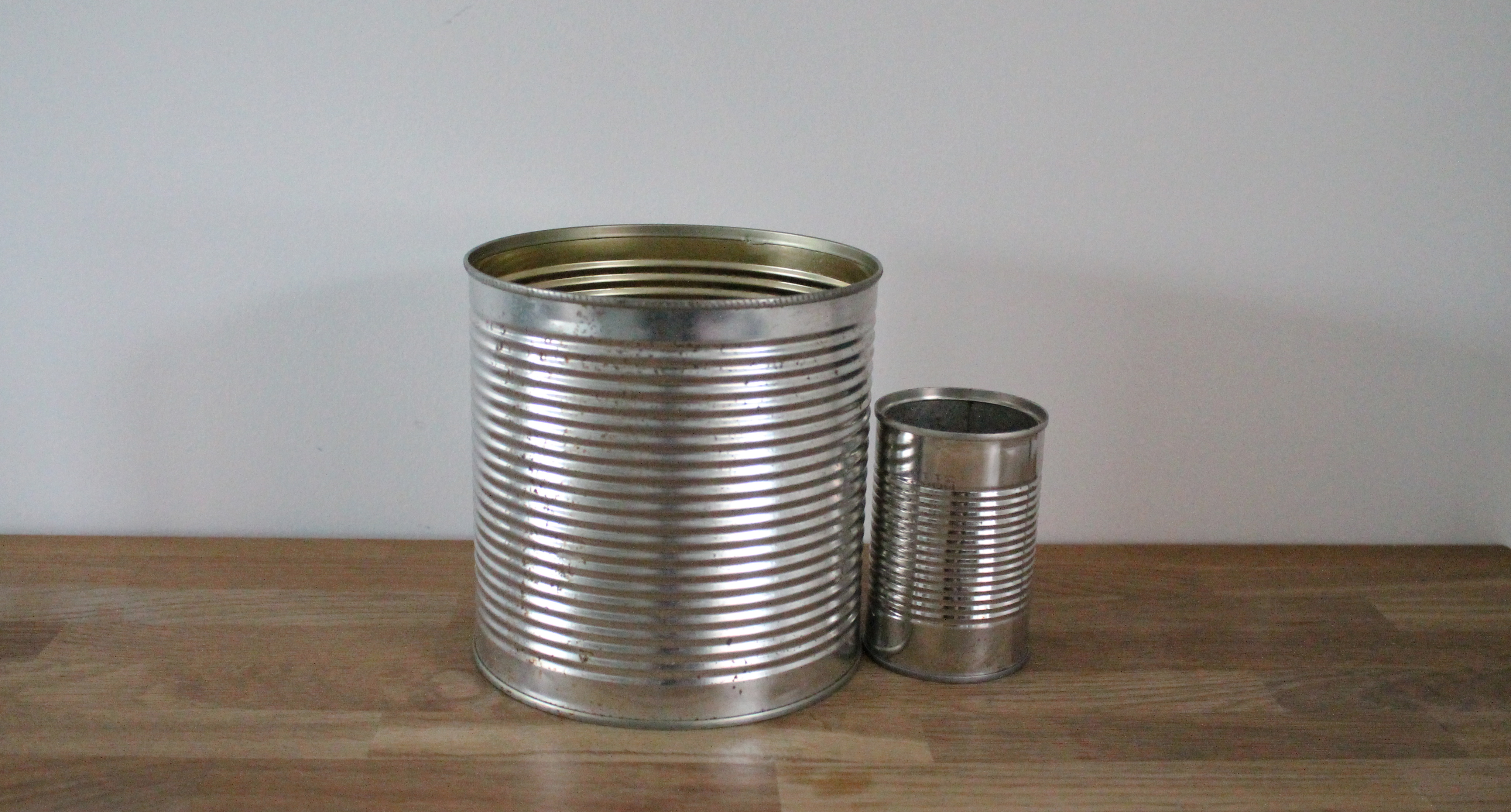 Metal wedding decor the little lending company for Aluminum can decorations